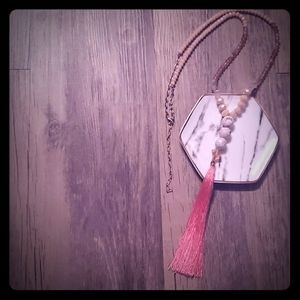 Long coral tassel necklace